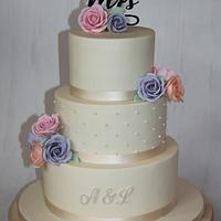Wedding cake - with dots and coloured sugar roses