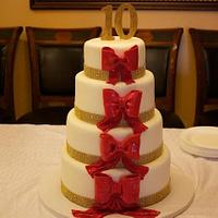 Anniversary Cake adourned with Large Red Bows