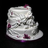 Dazzlelicious Bow, fabric and flowered wedding cake
