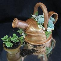Growing oregano cupcake and tin shower plants cake
