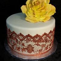 Copper cake lace and gumpaste rose