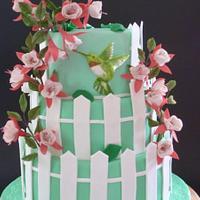 colibri cake with fuschia flowers