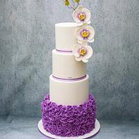 White / Purple Wedding Cake with Ruffles and Orchids