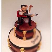 Guitarist on rustic drum