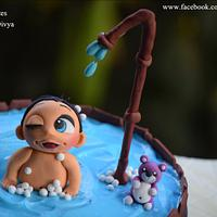 Naughty baby in a bathtub cake