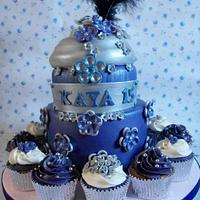 2 tier birthday cake with cupcakes