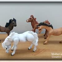 Hand modelled fondant icing horses