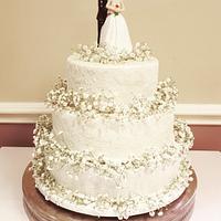 White lace wedding cake with gypsophilia