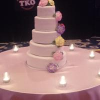 Wedding cake with flowers and a deer