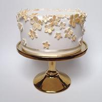 Gold and white bridal shower cake