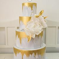 Concret wedding cake with gold accent and wafer paper flower <3
