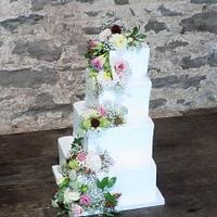 Stepped square wedding cake with Fresh blooms