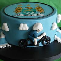 Man City and cycling themed cake  by yvonne