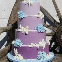 Shells and Blue hydrangeas Purple Ombre wedding cake