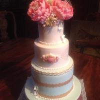 Peony rose and gold accents wedding cake