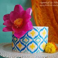 Hand-painted Ikat pattern cake with stylized wafer paper lotus