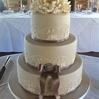 Piped wedding cake with peonie