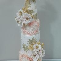 Wedding cake in peach , gold and peony