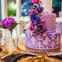 Purple & Gold wedding cake and dessert table!