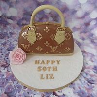 Louis Vuitton handbag cake.