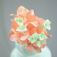 Coral Bougainvillea and Teal Puya on a Cake