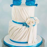 Bluebirds and roses wedding cake