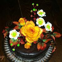 Chocolate cake with autumn flowers