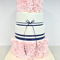 Pretty pink and navy ruffle Rose cake
