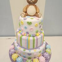 Buttons and cubes baby's cake