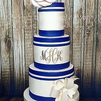 Navy, blush, and gold monogram wedding cake