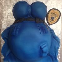 Pregnant police officer belly cake