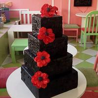 Black cake with red anemonies