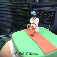 Cricket player cake