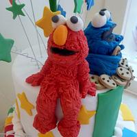 Elmo and Cookie monster cake by The cake shop at highland reserve