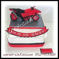 A red motorcycle cake