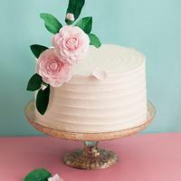 Buttercream cake decorated with sugar camellias