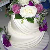 Swag Wedding cake with fresh flowers by Creative Cakes by Chris