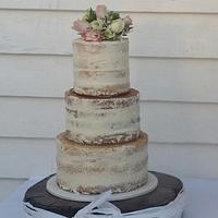 Semi naked three tier wedding cake