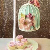 Gravity defying bird cage cake