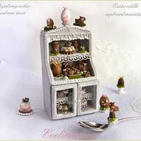 Edible miniature food on cookie cupboard