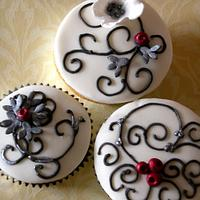 Black & white winter wedding cake & cupcakes