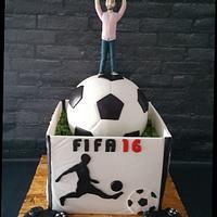 Soccer ball and playstation box cake .