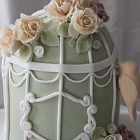 Vintage birdcage with roses