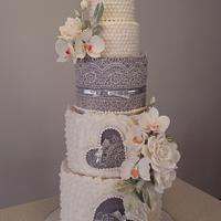 Wedding cake with orchids and roses ...