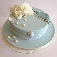Birthday cake in duck egg blue and ivory