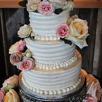 Buttercream wedding cake fresh flowers