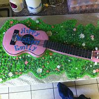 Pink guitar.