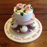 Anniversary cake with rolled fondant cupcakes