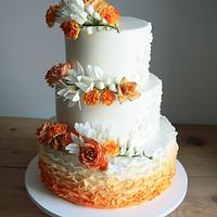 White / orange wedding cake