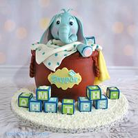 Basket cake with a baby elephant.
